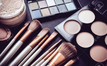 60728835-professional-makeup-brushes-and-tools-collection-make-up-products-set-on-black-table-background-